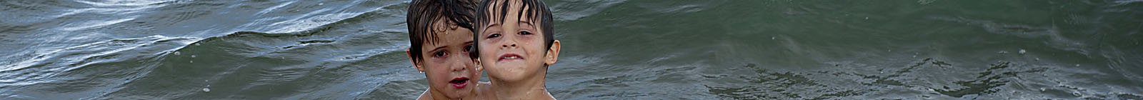 Chachalacas Beach, boys in water. - Banner