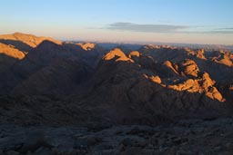 Sun sheds first light on cold desert mountains. Sinai after sunrise.