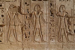 Egyptian hieroglyphs in stone. Medinet Habu temple.