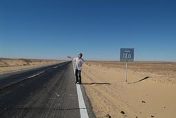 Bagdad 145km sign, desert road Egypt.