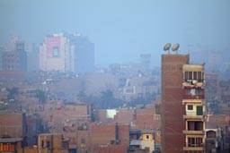 Morning satelite dishes Cairo and smog.