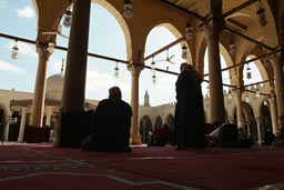 Mosque of Amr ibn al-As, Cairo. Mulsims pray.