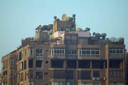 Satelite dishes Cairo appartment block roof.