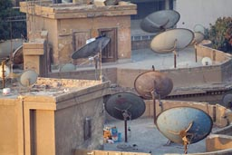 Cairo roof top, satelite dishes.