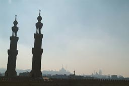 On top of Sultan Muaiyad, Bab Sweila minarets. Other mosques in distance, smoggy Cairo.