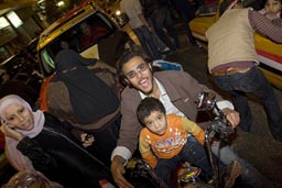 Man, woman, child, moped CAN 2010 Egyptian victory celbrations.