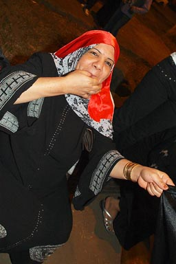 Muslim woman whistling, Cairo street celebrations of CAN football 2010 win.