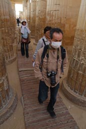 My friends in Saqqara. Tourists wearing facemasks, Egypt.