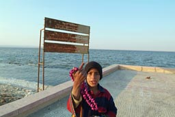 Qarum lake, kid selling shell necklace, Egypt.
