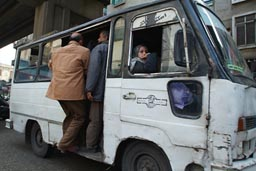 People entering overcrowded bus, Cairo.