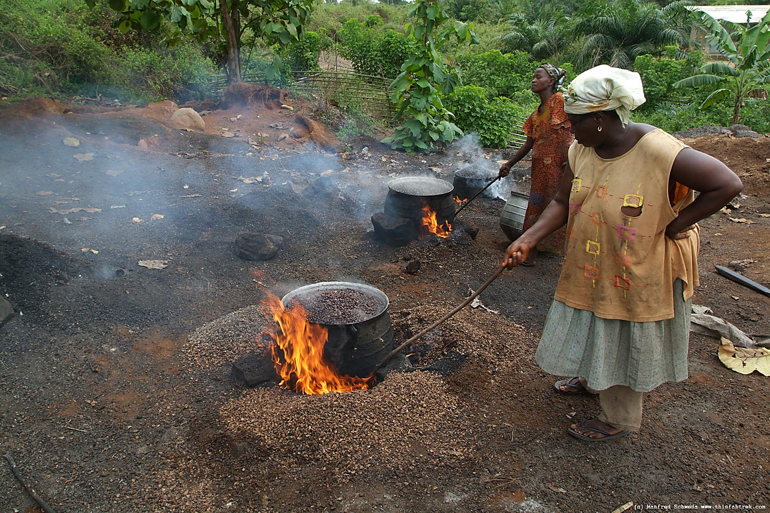 Old African Woman Cooking