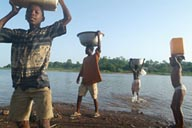 Lake Volta Ghana, kids fetch water.