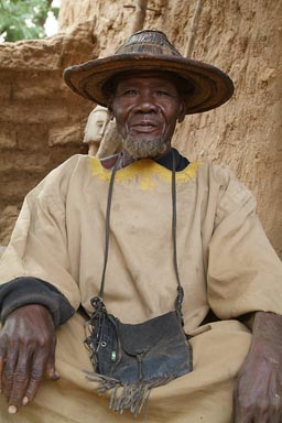 Dogon trader, in his shop, traditional Dogon hat.