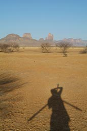Shadow of me in front of Hand of Fatima, Mali, taking pictures.