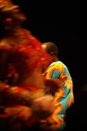 Femi Kuti behind dancer.