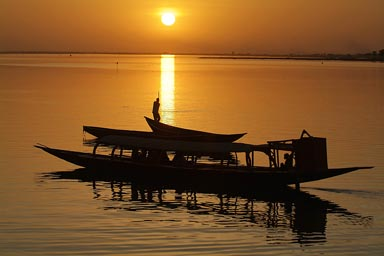 Golden sunest on the Niger River, pirogues.