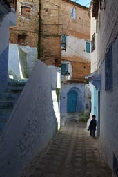 Chefchaouen, alley blue and white, boy
