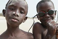 African boys on beach in Djembering.