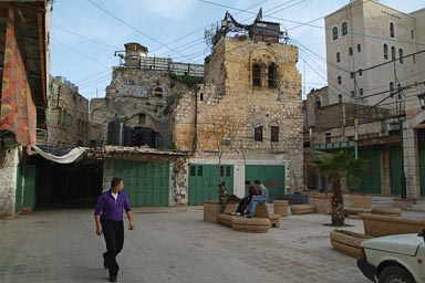 Hebron, Palestine, watch tower on top of old town, Jewish settlement right.
