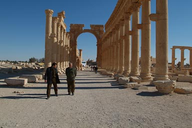 Decumanus, collonades, Palmyra, men walking.