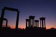 Palmyra, new moon and silhuette of Tertapylon at dusk.