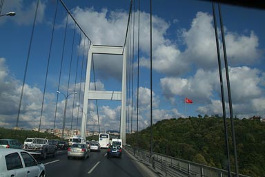 Fatih Sultan Mehmet Bridge over Bosporous. Turkish Flag on Aian side.