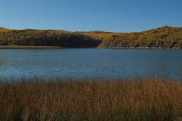 Crater Lake, reed, blue lake and sky, autumn. Turkey.