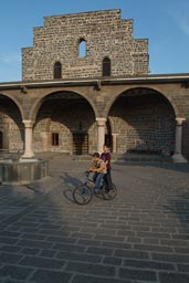 Aramaean church, boys on bycicle. Diyarbakir.