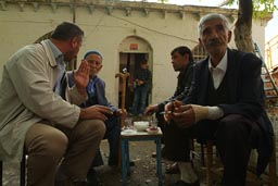 Hani, Turkey, Men and tea and cigarettes, cafe near sacred spring.