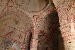 Ochre paintings in cave church dome. Cappadokia.