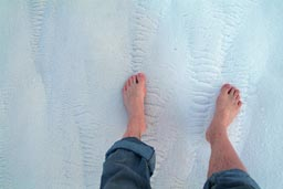 Feet on white chalky soil, Pamukkale.