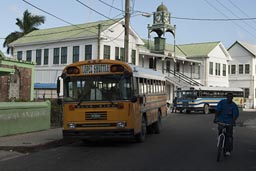 Yellow bus on Regent's Street outside Presbyterian church Belize City.