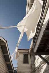 White sheets from laundry fly every day outside Isabel's guest house in Belize City..