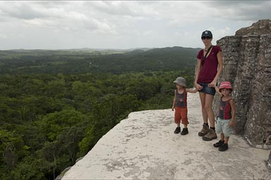 On top of Maya pyramid, Xunantunich, view over jungle, the boys would rather run around..