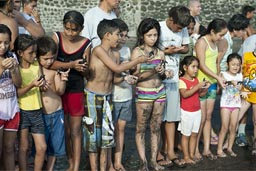 Children holding turtles stand in a line, El Zonte, El Salvador. Turtle project.