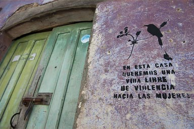 In this house we want a life free of violence against women. Sprayed on every other house in Suchitoto, El Salvador.