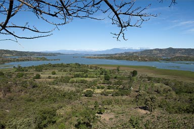 Lago Suchitoto, blue lake nested in surrounding hills. El Salvador.