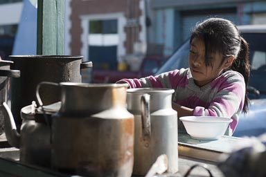 San Marcos, early morning, girl steers in a pot, Street Cafe near central market, Western Highlands Guatemala