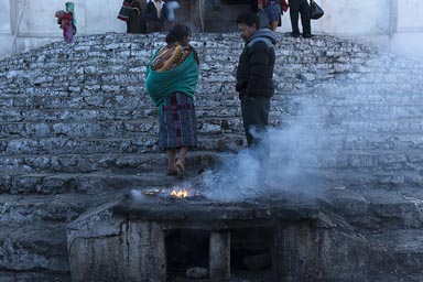 Incense burns on steps of Santo Tomaso  church in Chichicastenango, Guatemala.
