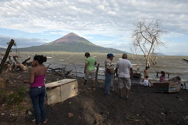 Volcano Momotombo, Lake Managua, at Leon Viejo village, very rough lake.