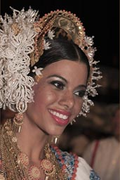 Most beautiful of the carnival queens, lots of gold around her neck. Las Tablas, Panama.