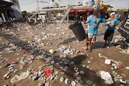 Empty cans, trash piles after the carnival, Las Tablas, Panama.