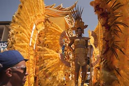 yellow feathered cart with golden feathered queen, carnaval, Las Tablas, Panama.
