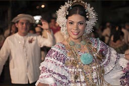She dances along, always, a queen one day, a queen always, an expensive carnival dress, lots of gold, Las Tablas, Panama.