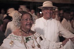 Happy posing elder carnival couple, Las Tablas.