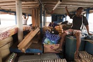 The load on the commercial cutter, leaving from Miramar to Porvenir, Guna Yala, rough sea, Panama.
