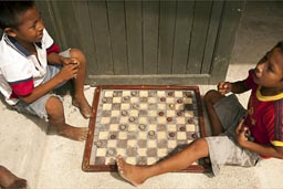 Playing checkers in Guna Yala, Island of San Ignacio.