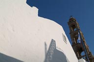 Lindos, orthodox church-Greek flag, white walls.