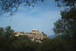 Acropolis, between trees, from far.