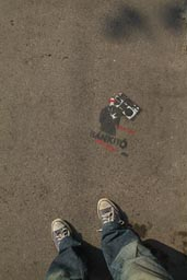 Sprayed mark on pavement, Convers in Budapest.
